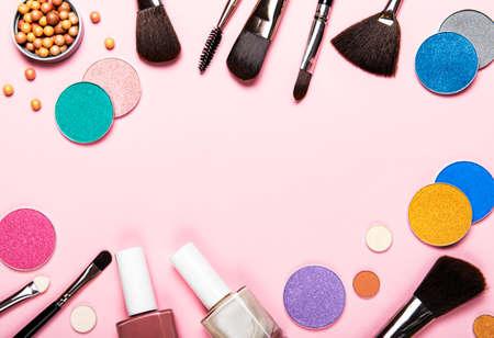 Set of decorative cosmetics on a pastel pink background. Flat lay, top view. Reklamní fotografie