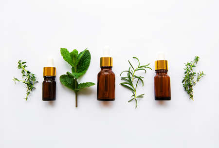 Aromatherapy concept, aroma oil and herbs - mint, rosemary, thyme on a white background, top view Zdjęcie Seryjne