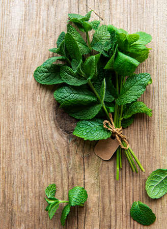 Fresh mint leaves on old wooden background, flat lay Stock fotó