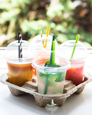 Various summer cold drinks and cocktails in a paper holder 写真素材