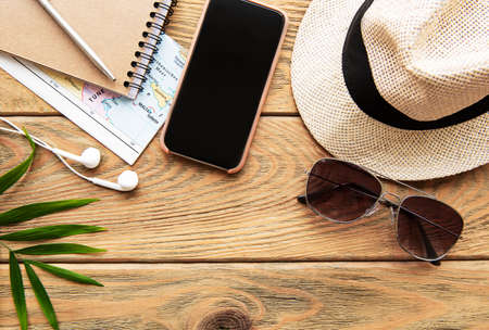 Summer holiday background, travel concept with camera on wooden table background. Flat lay