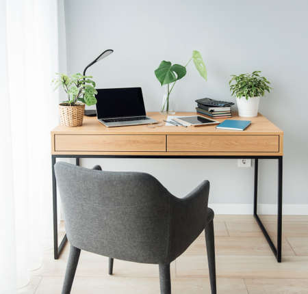 Office workplace with laptop on wooden table
