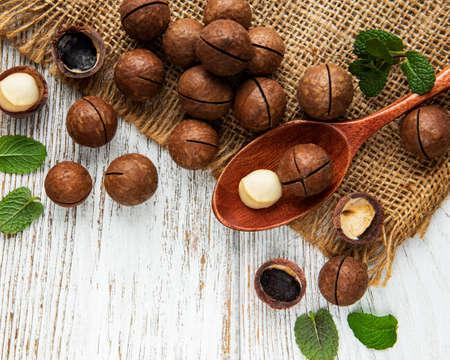 Organic Macadamia nuts on a wooden table Banco de Imagens