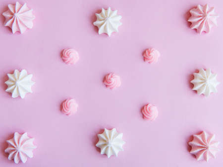 Merengue background. Flat lay. Top view. Sweet homemade merengue on pink background.