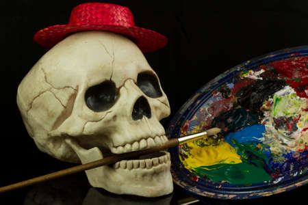 Skull with a paint brush and oil paints