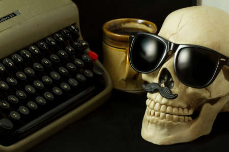 Skull with Hipster glasses, typewriter and a cup of coffee