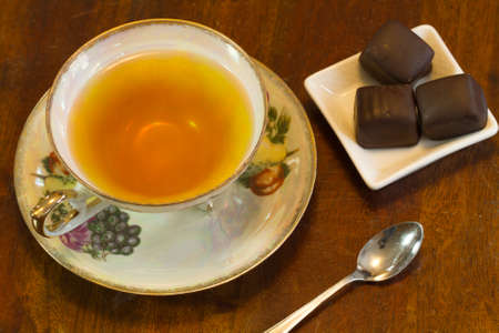 Tea served with chocolate truffles and aroma therapy Stock Photo - 38235533