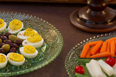 Deviled eggs, kalamata and green olives served with carrots, jimaca and cherry tomatoes as a before dinner horderve Banco de Imagens
