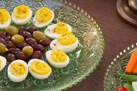 deviled eggs: Deviled eggs, kalamata and green olives served with carrots, jimaca and cherry tomatoes as a before dinner horderve Stock Photo
