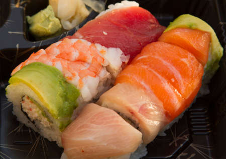 whitefish: Sushi made with salmon, tuna, and whitefish as a party horderve serving