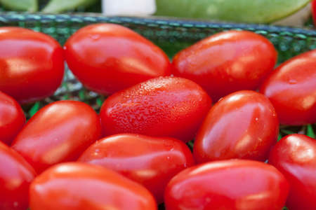 snap: Plated tomatoes, jimaca and snap peas as a before dinner snack Stock Photo