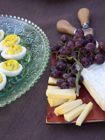 deviled eggs: Deviled eggs, kalamata and green olives with brie and Gouda and grapes served as horderves before dinner
