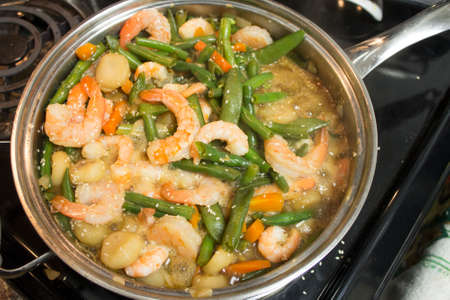 wine sauce: Shrimp Caserole made with beans, shallots and wine sauce