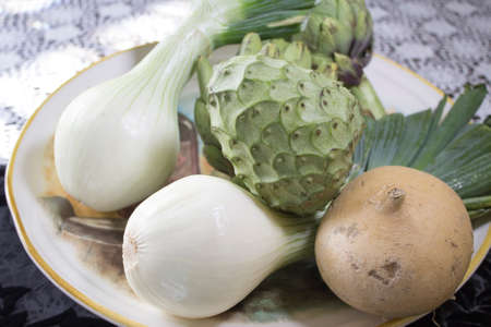 chirimoya: Green onion shallots with Chirimoya, Jimaca, and Artichoke ready for a dinner preparation Stock Photo