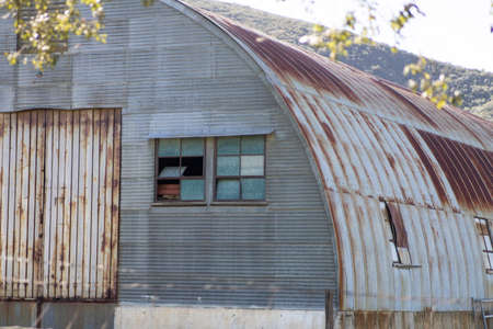Building shed made of corrugated metal and rusted deterioration
