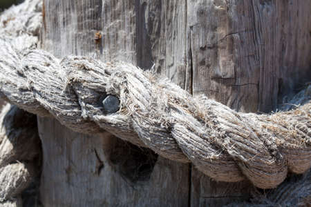 A knotted rope fence post.