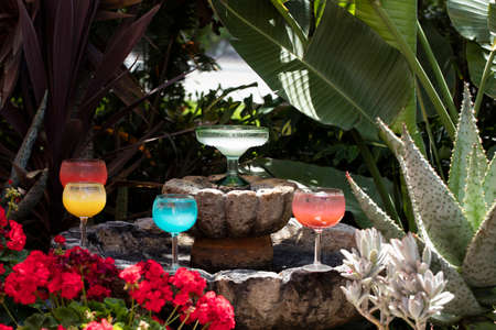 Various colored Margarita drinks on a decorated fountain