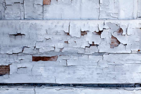 wood textures: Distressed building wall with white aged paint chipping off Stock Photo