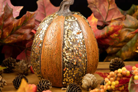 Lovely decorative pumpkin placed as a table center for Thanksgiving