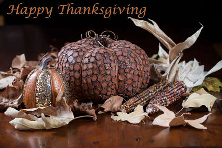 to get warm: Orange Pumpkins, small gourds and Indian corn set on a table as a Thanksgiving decoration