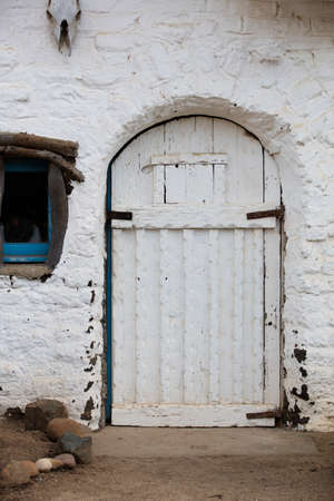 carlsbad: Entry door to an old and distressed adobe building in Leo Carrillo Park in Carlsbad California