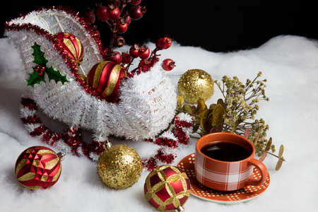 saint nick: Home decor Santa and his sleigh on snow and tree decorations table setting accompanied by a warm cup of coffee