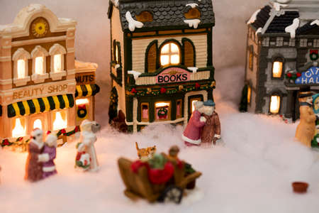 miniature christmas village scene with houses trees people dogs and cats celebrating the - Miniature Christmas Village
