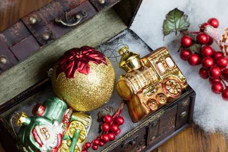 jewelry box: Christmas decorations set in a vintage jewelry box on a wood table