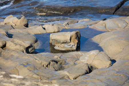 myst: Solitary Rock In Pool of Water and Reflection at La Jolla California