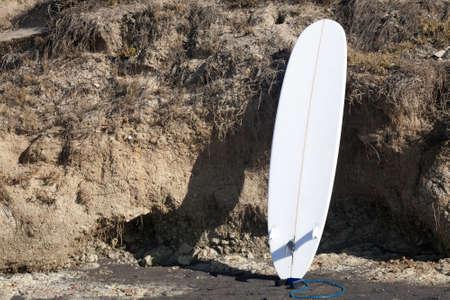 boogie: Surfboard On Cliffside Stock Photo