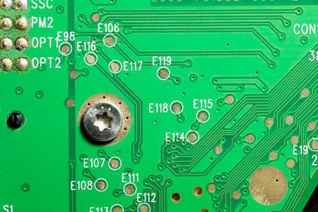 コンピューターのハード ドライブに古いの挨りだらけの電子回路イノシシ 写真素材
