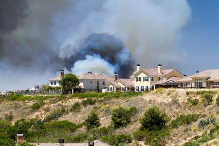 billowing: Fire billowing smoke in Carlsbad, California in 2014 Stock Photo