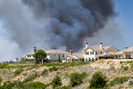 billowing: Fire billowing smoke in Carlsbad, California in 2014 Stock Photo