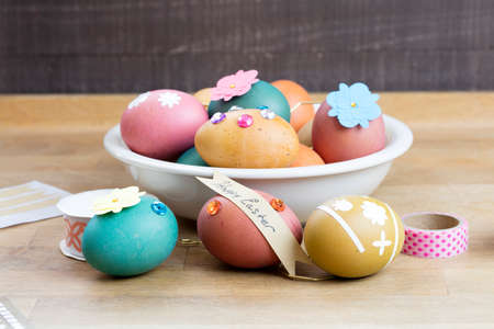 Easter egg ribbons, cutouts, stones and designer tape for coloring and decorating for the holiday Stock Photo