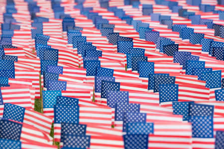 United States flags lined up near the coast  to commemorate the 9-11 event Stock Photo