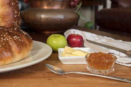 to get warm: Turkey bread freshly baked and served with butter and orange marmalade Stock Photo