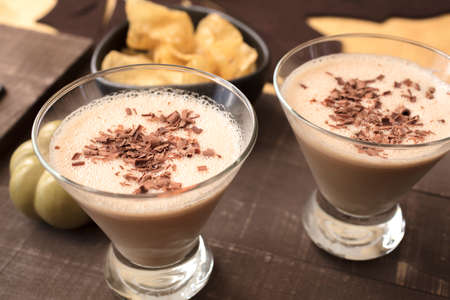 Two glasses filled with a milk, amaretto, hazelnut liqueur drink for a holiday get together Banco de Imagens