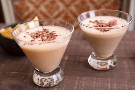 amaretto: Two glasses filled with a milk, amaretto, hazelnut liqueur drink for a holiday get together Stock Photo