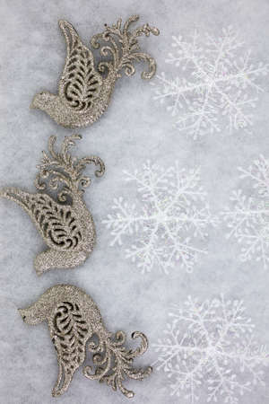 Christmas doves and snowflakes decorated as a Christmas greeting background in white and gold