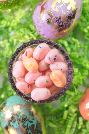 jelly beans: Easter Eggs and Jelly Beans in a glass container and on green crepe paper