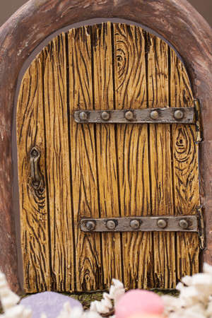 Entry toy doorway for an Easter decoration made of ceramic, but made to look like wood