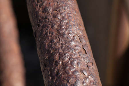 Rusted, peeling and bumpy  textured handrail