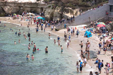 Crowd of People on a warm Summers Day enjoying the beach life  at La Jolla Cove, California