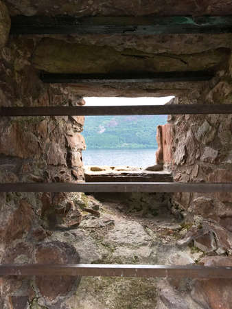 Window view of Loch Ness from Urquhart Castle in Drumnadrochit, Inverness, Scottish Highlands United Kingdom Europe