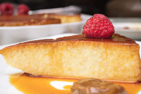 Creamy Flan dessert served  with raspberries and Dulce De Leche Stock Photo