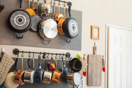 Kitchen wall rack for hanging pots, pans, aprons, and other utensils for efficient organization, storage and decor