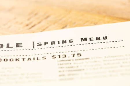 Restaurant menu listing the spring items for the season and pricing Imagens