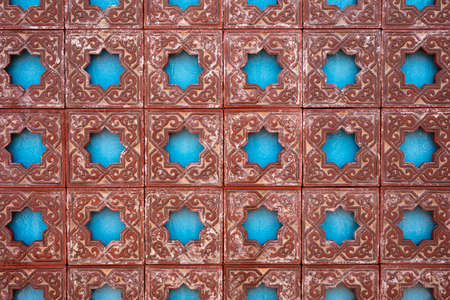 Fountain wall with a Moorish design in tilework in reds and blues