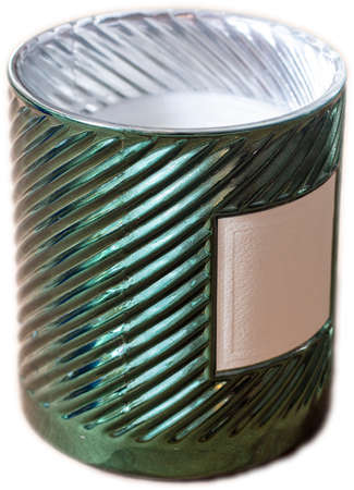 Cylindrical green candle holder with white candle and blank lable as an isolated object