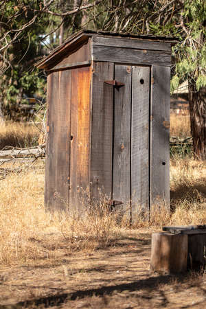 Old wood outhouse with a tin roof